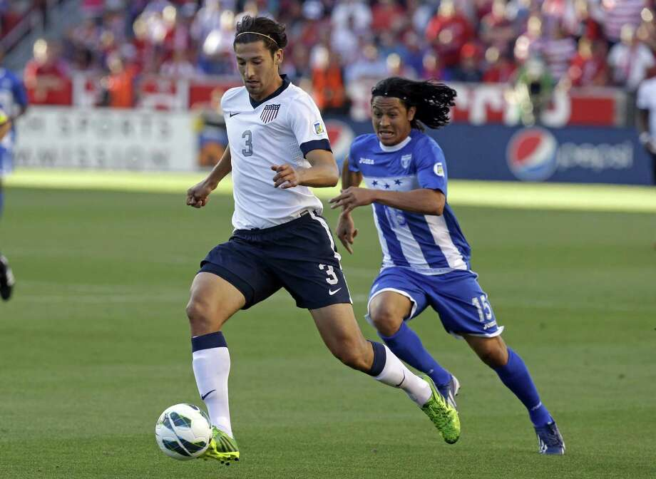 Honduras' Roger Espinoza (15) defends as United States' Omar Gonzalez (3) clears the ball in the first half during a World Cup qualifying soccer match at Rio Tinto Stadium on Tuesday, June 18, 2013, in Sandy, Utah.  (AP Photo/Rick Bowmer) Photo: Rick Bowmer, Associated Press / AP