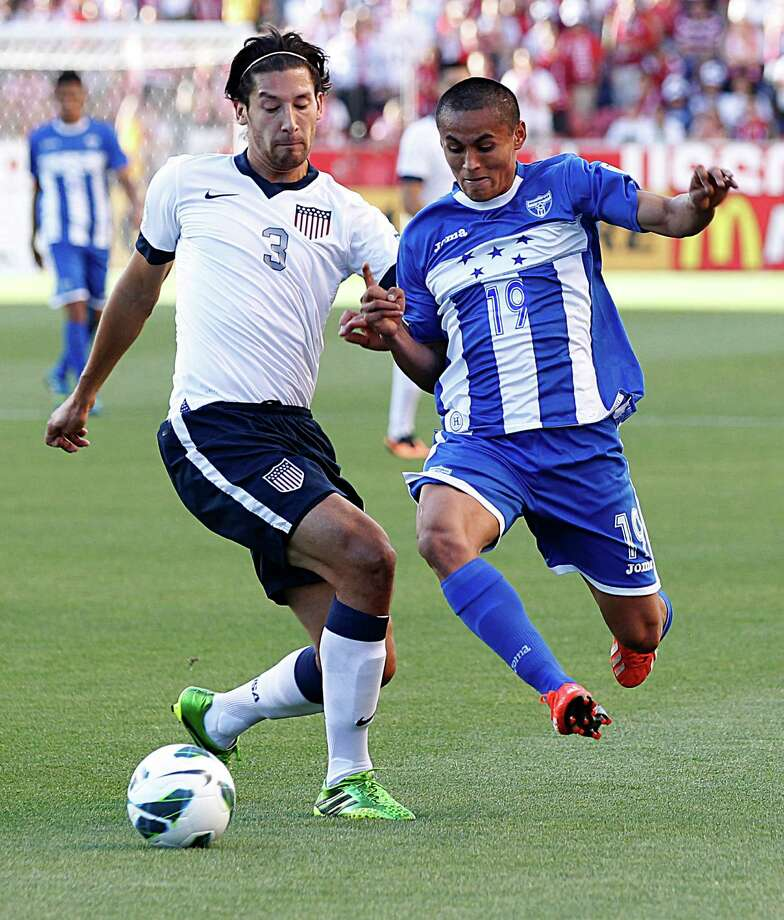 SANDY, UT - JUNE 18: Omar Gonzalez #3 of the United States and Andy Najar #19 of Honduras fight for the ball during the first half of a World Cup qualifying match on June 18, 2013 at Rio Tinto Stadium in Sandy, Utah. Photo: George Frey, Getty Images / 2013 Getty Images