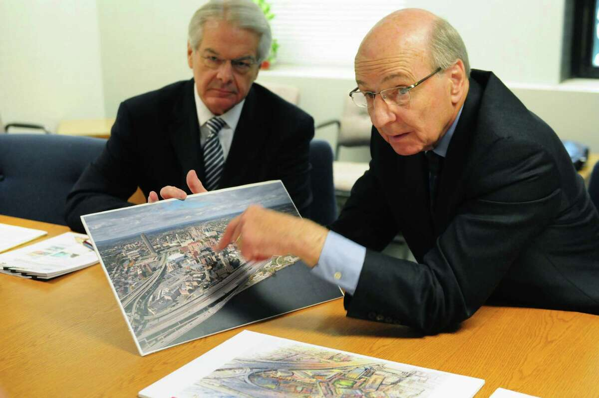 I. David Swawite, right, president and CEO of Omni Development Company, points to an aerial photograph of Albany which shows the proposed site of planned aquarium and technology museum, Tuesday June 18, 2013, at the Times Union in Colonie, N.Y. Tim Nowak, president of Nowak Associates is pictured left. (Will Waldron/Times Union)