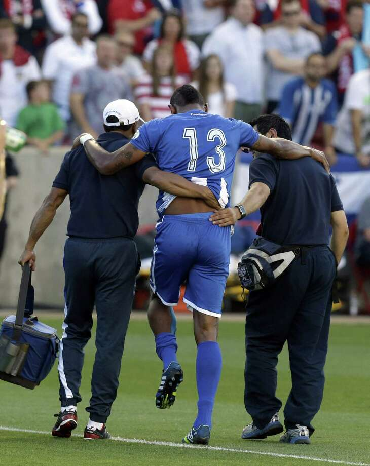 Honduras' Carlo Costly (13) is helped off the field after being injured in the first half during a World Cup qualifying soccer match against the United States, at Rio Tinto Stadium on Tuesday, June 18, 2013, in Sandy, Utah. (AP Photo/Rick Bowmer) Photo: Rick Bowmer, Associated Press / AP