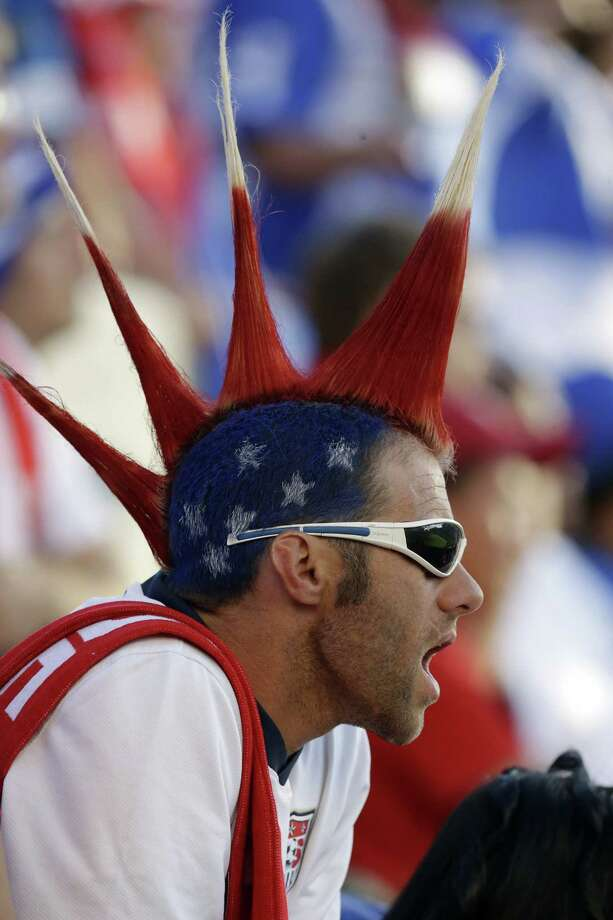 A United States fan cheers in the first half during a World Cup qualifying soccer match against Honduras at Rio Tinto Stadium on Tuesday, June 18, 2013, in Sandy, Utah. (AP Photo/Rick Bowmer) Photo: Rick Bowmer, Associated Press / AP