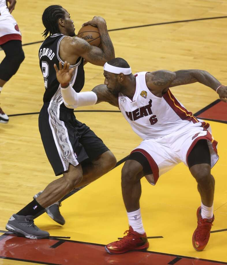 San Antonio Spurs' Kawhi Leonard drives past Miami Heat's LeBron James during the first half of Game 6 of the NBA Finals at American Airlines Arena on Tuesday, June 18, 2013 in Miami. (Jerry Lara/San Antonio Express-News)
