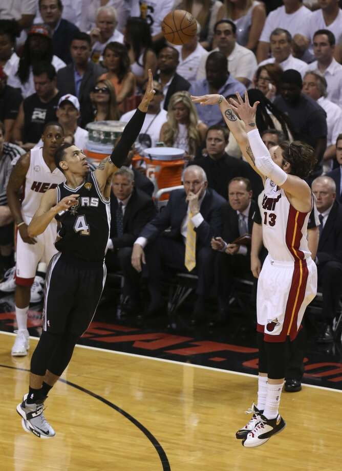 San Antonio Spurs' Danny Green defends against a three point shot by Miami Heat's Mike Miller during the first half of Game 6 of the NBA Finals at American Airlines Arena on Tuesday, June 18, 2013 in Miami. (Jerry Lara/San Antonio Express-News)