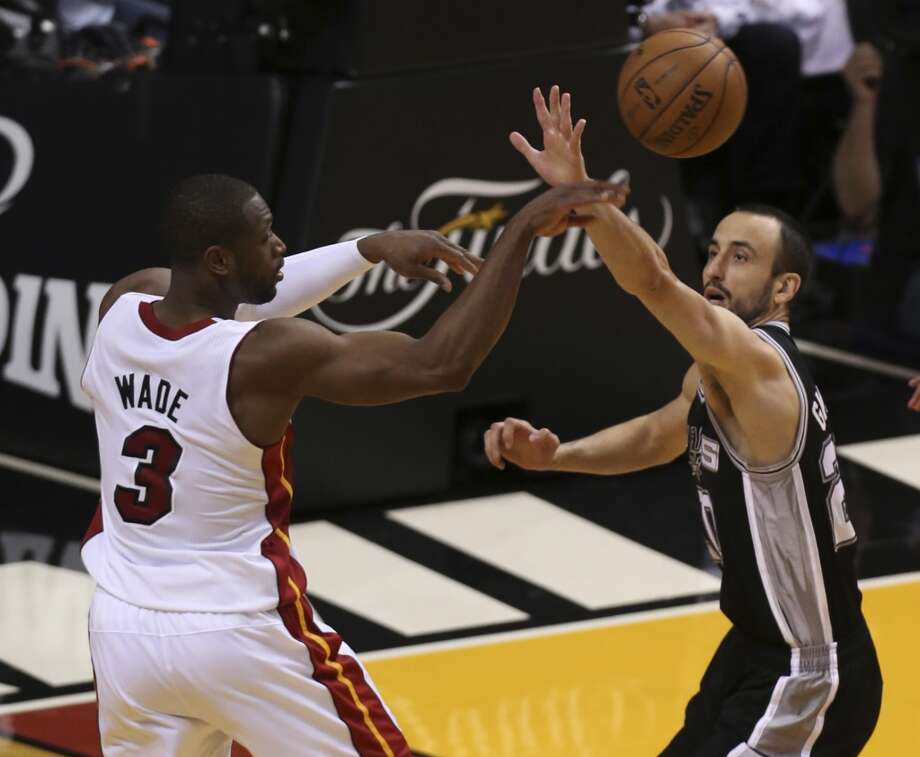 San Antonio Spurs' Manu Ginobili defends against Miami Heat's Dwyane Wade during the first half of Game 6 of the NBA Finals at American Airlines Arena on Tuesday, June 18, 2013 in Miami. (Jerry Lara/San Antonio Express-News)