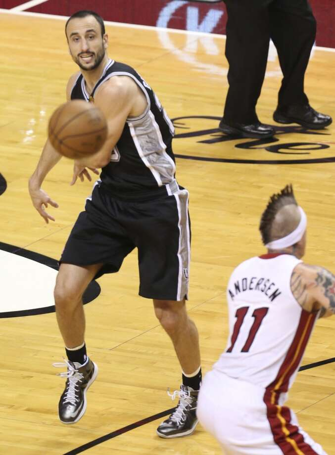 San Antonio Spurs' Manu Ginobili dishes to a teammate while Miami Heat's Chris Andersen defends during the first half of Game 6 of the NBA Finals at American Airlines Arena on Tuesday, June 18, 2013 in Miami. (Jerry Lara/San Antonio Express-News)