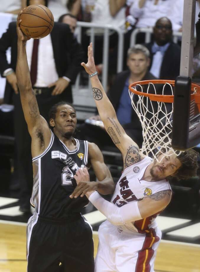 San Antonio Spurs' Kawhi Leonard shoots over =13= during the first half of Game 6 of the NBA Finals at American Airlines Arena on Tuesday, June 18, 2013 in Miami. (Jerry Lara/San Antonio Express-News)