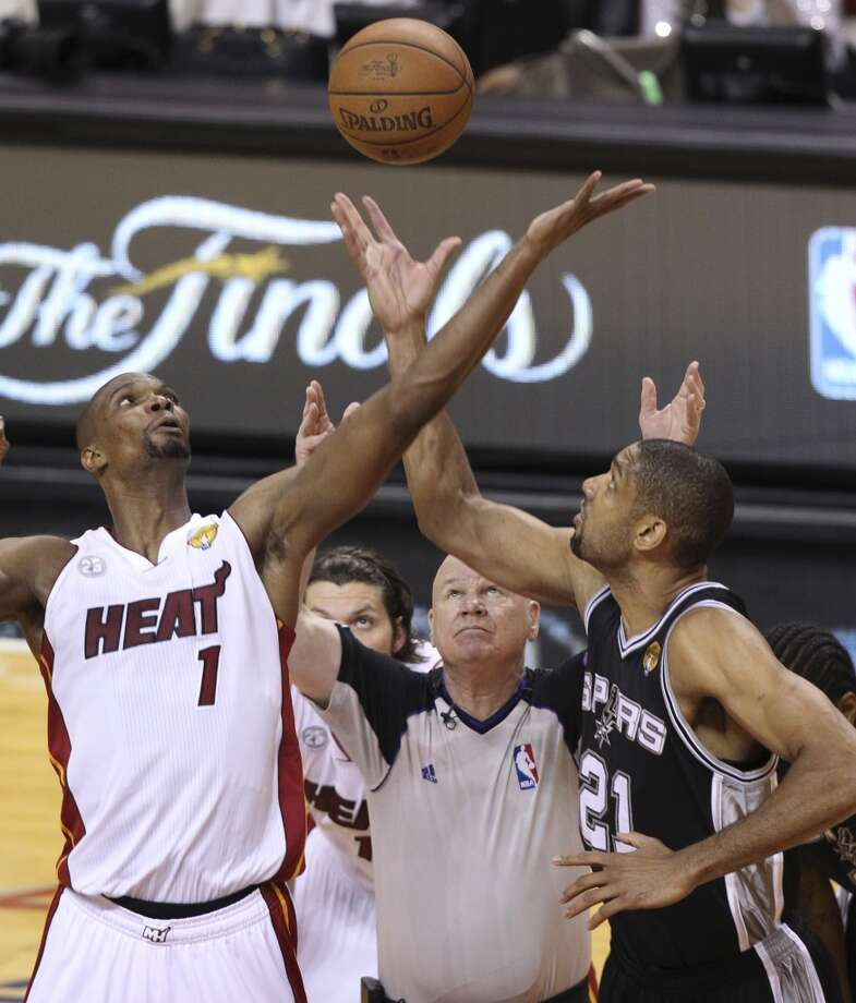 Miami Heat's Chris Bosh tips off against San Antonio Spurs' Tim Duncan during the first half of Game 6 of the NBA Finals at American Airlines Arena on Tuesday, June 18, 2013 in Miami. (Kin Man Hui/San Antonio Express-News)