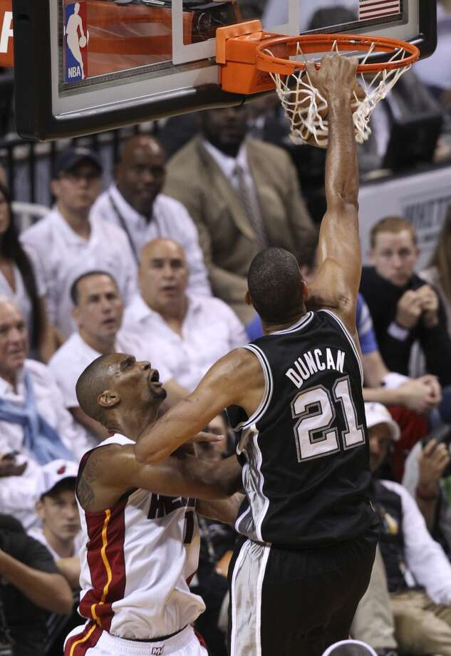 San Antonio Spurs' Tim Duncan dunks over Miami Heat's Chris Bosh during the first half of Game 6 of the NBA Finals at American Airlines Arena on Tuesday, June 18, 2013 in Miami. (Kin Man Hui/San Antonio Express-News)