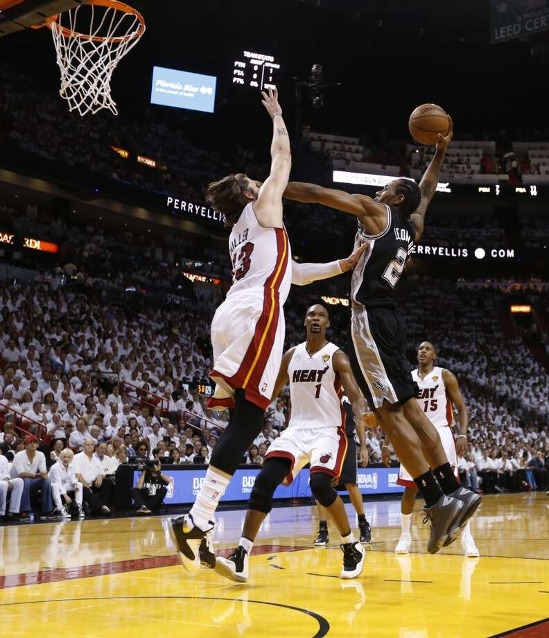 San Antonio Spurs' Kawhi Leonard shoots over Miami Heat's Mike Miller during first half action in Game 6 of the 2013 NBA Finals Tuesday, June 18, 2013 at American Airlines Arena in Miami. (Edward A. Ornelas/San Antonio Express-News)