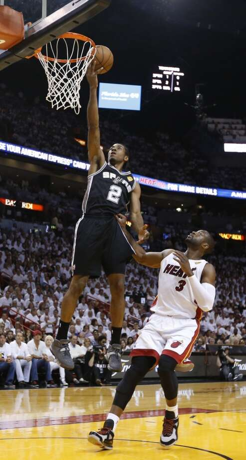 San Antonio Spurs' Kawhi Leonard shoots over Miami Heat's Dwyane Wade during first half action in Game 6 of the 2013 NBA Finals Tuesday, June 18, 2013 at American Airlines Arena in Miami. (Edward A. Ornelas/San Antonio Express-News)