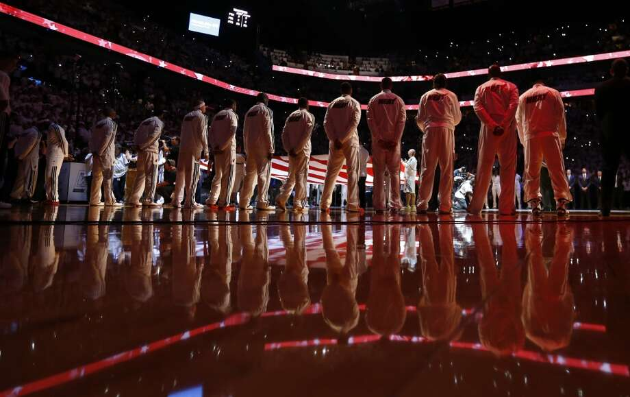 The Miami Heat stand for the national anthem before the first half action in Game 6 of the 2013 NBA Finals Tuesday, June 18, 2013 at American Airlines Arena in Miami. (Edward A. Ornelas/San Antonio Express-News)
