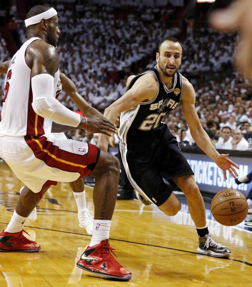 San Antonio Spurs' Manu Ginobili looks for room around Miami Heat's LeBron James during first half action in Game 6 of the 2013 NBA Finals Tuesday, June 18, 2013 at American Airlines Arena in Miami. (Edward A. Ornelas/San Antonio Express-News)