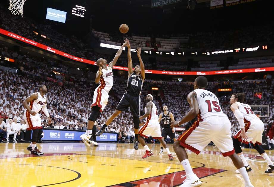 San Antonio Spurs' Tim Duncan shoots over Miami Heat's Chris Bosh during first half action in Game 6 of the 2013 NBA Finals Tuesday, June 18, 2013 at American Airlines Arena in Miami. (Edward A. Ornelas/San Antonio Express-News)