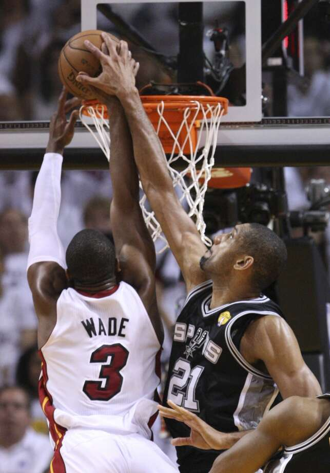 San Antonio Spurs' Tim Duncan defends against a shot by Miami Heat's Dwyane Wade during first half action in Game 6 of the 2013 NBA Finals Tuesday, June 18, 2013 at American Airlines Arena in Miami. (Edward A. Ornelas/San Antonio Express-News)