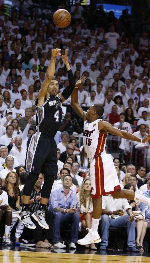 San Antonio Spurs' Danny Green shoots over Miami Heat's Mario Chalmers during first half action in Game 6 of the 2013 NBA Finals Tuesday, June 18, 2013 at American Airlines Arena in Miami. (Edward A. Ornelas/San Antonio Express-News)