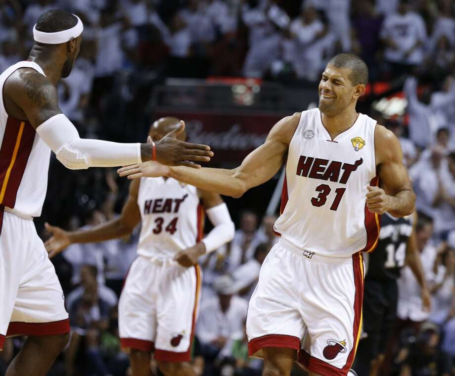 Miami Heat's Shane Battier gets a high five from Miami Heat's LeBron James during first half action in Game 6 of the 2013 NBA Finals Tuesday, June 18, 2013 at American Airlines Arena in Miami. (Edward A. Ornelas/San Antonio Express-News)