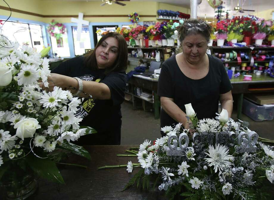Janine Sanchez and Yolanda Verastegui prepare arrangements at Robert's Flower Shop. The store has seen an increase in orders for Spurs floral arrangements during the playoffs. Photo: Helen L. Montoya / San Antonio Express-News