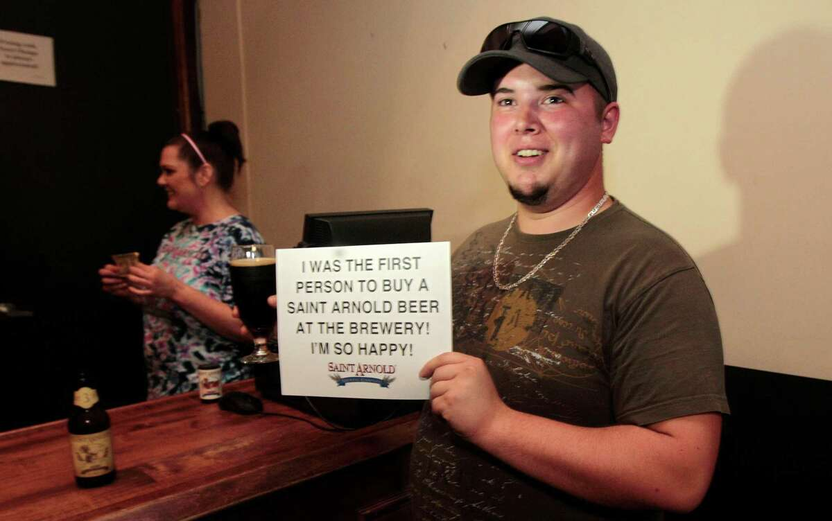 Dale Edwards was sold the first beer ever bought at St. Arnold Brewery, in accord with a new state law that went into effect Saturday. (Billy Smith II / Chronicle)