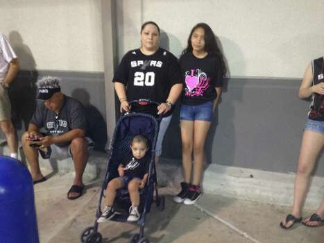 "Stacie Giddens, a San Antonio native, said it's always been a tradition for her family to wait in line for Spurs playoff merchandise. ""My mom and I would do it every year during the playoffs,"" Giddens says. ""We would get shirts for the whole family."" Gidden's mother, Dorthy, passed away this last February. She now takes her kids, 19-month-old Gabriel and 12-year-old Alyssa, to wait in line. ""We are getting shirts for my sister, who's out of town and my dad who's working a night shift,"" says Stacie. ""We're just continuing the tradition."" Photo: Elise Brunsvold / San Antonio Express-News"