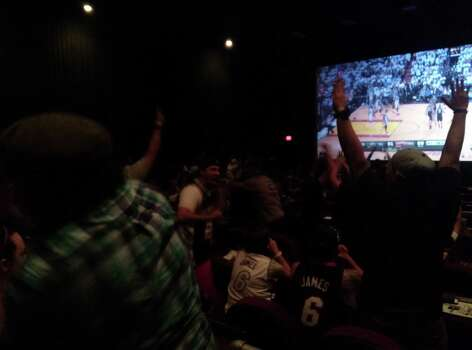 The crowd goes wild at the Westkake Alamo Drafthouse as the Spurs take the lead in the final minute of Game 6. Photo: David G. Palacio / San Antonio Express-News