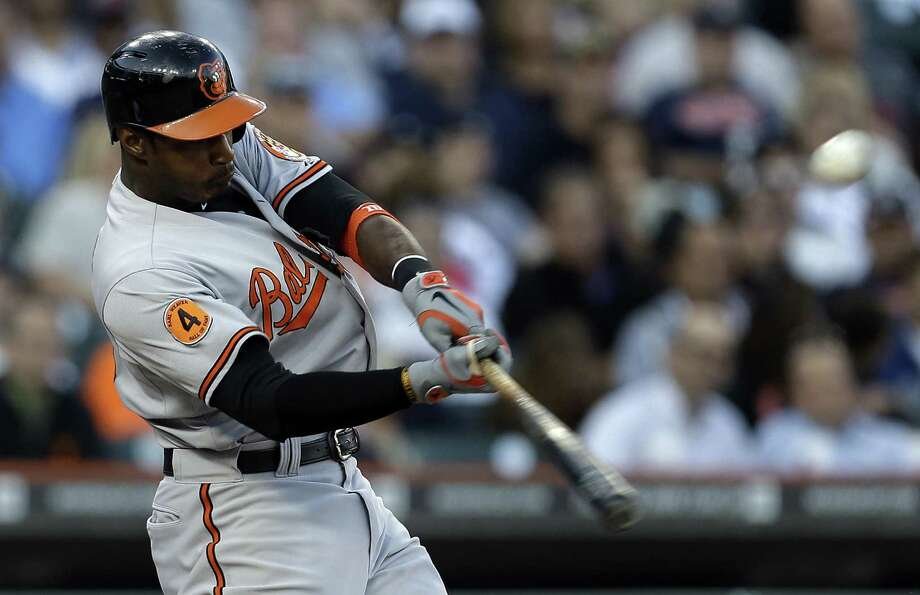 Baltimore's Adam Jones connects for a three-run homer during the fifth inning against Detroit. Photo: Paul Sancya / Associated Press