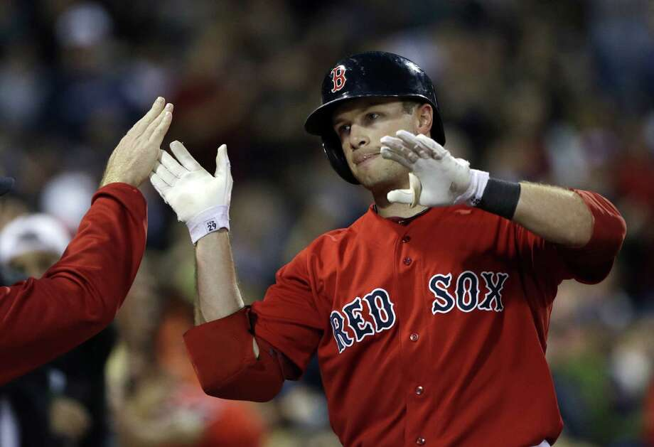 Boston's Daniel Nava celebrates his solo home run during the second inning of Game 2 at Fenway Park. Photo: Elise Amendola / Associated Press