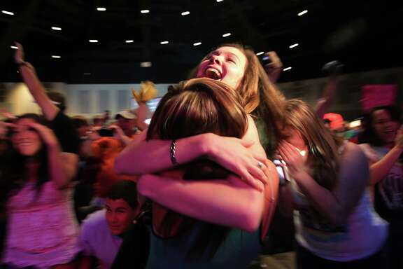 "Monica Bradbery, 22, embraces friend Brooke Stanfield on Tuesday night after her sister Danielle is announced the winner of ""The Voice"" during a watch party at the Community of Faith in Hockley."