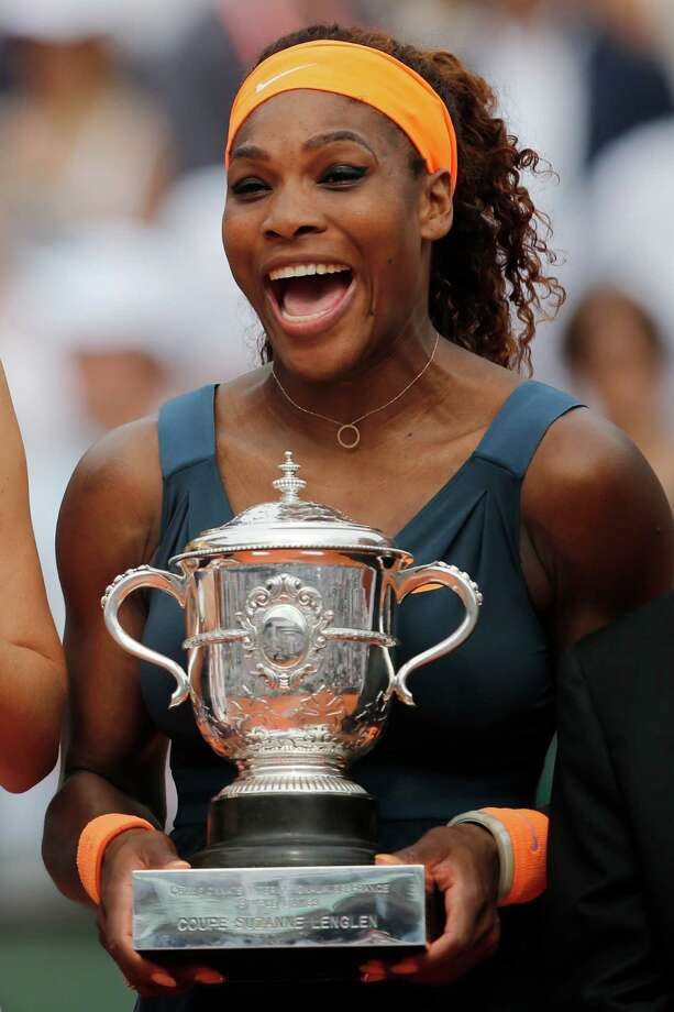 Serena Williams of the U.S. holds the trophy after defeating Russia's Maria Sharapova in two sets 6-4, 6-4, in the women's final of the French Open tennis tournament, at Roland Garros stadium in Paris, Saturday June 8, 2013. (AP Photo/Christophe Ena) Photo: Christophe Ena, STF / AP