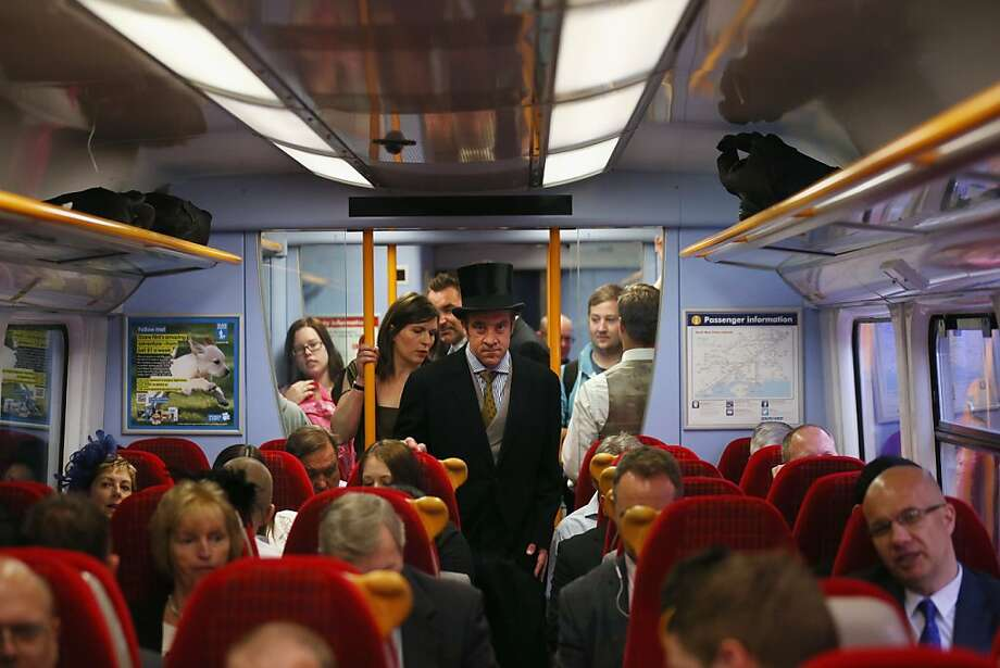LONDON, ENGLAND - JUNE 18:  Racegoers travel by train from Waterloo station to Ascot racecourse to attend Royal Ascot on June 18, 2013 in London, England. The 'Royal Ascot' horse race meeting runs from June 18, 2013 until June 22, 2013 and has taken place since 1711. The racecourse is expected to welcome around 280,000 racegoers over the five days, including Her Majesty The Queen and other members of the Royal Family.  (Photo by Oli Scarff/Getty Images) Photo: Oli Scarff, Getty Images