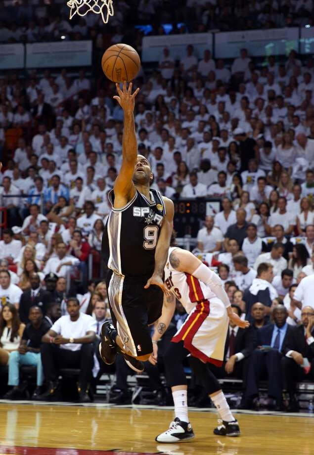 Spurs point guard Tony Parker attempts a shot against the Heat. Photo: Mike Ehrmann, Getty Images