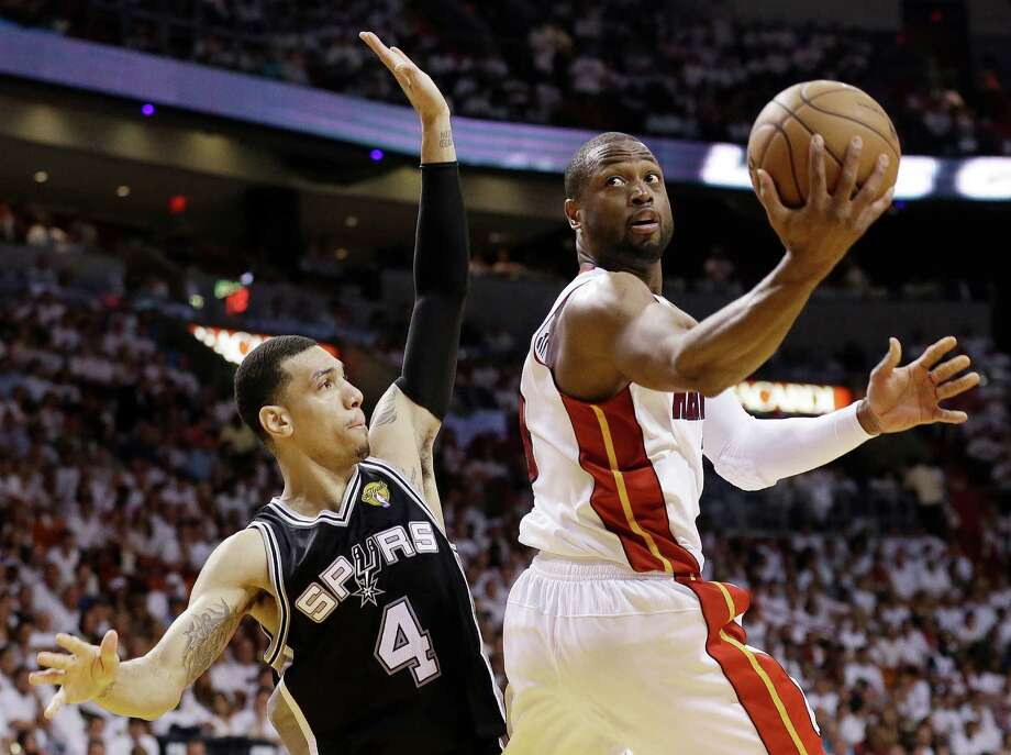 Miami Heat shooting guard Dwyane Wade (3) shoots against San Antonio Spurs shooting guard Danny Green (4) during the second half of Game 6 of the NBA Finals basketball game, Tuesday, June 18, 2013 in Miami. (AP Photo/Lynne Sladky) Photo: Lynne Sladky