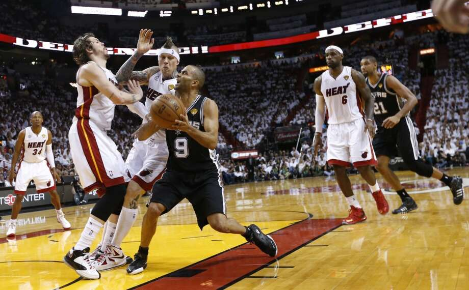 San Antonio Spurs' Tony Parker drives past Miami Heat's Mike Miller and Chris Andersen during first half action in Game 6 of the 2013 NBA Finals Tuesday, June 18, 2013 at American Airlines Arena in Miami. (Edward A. Ornelas/San Antonio Express-News)