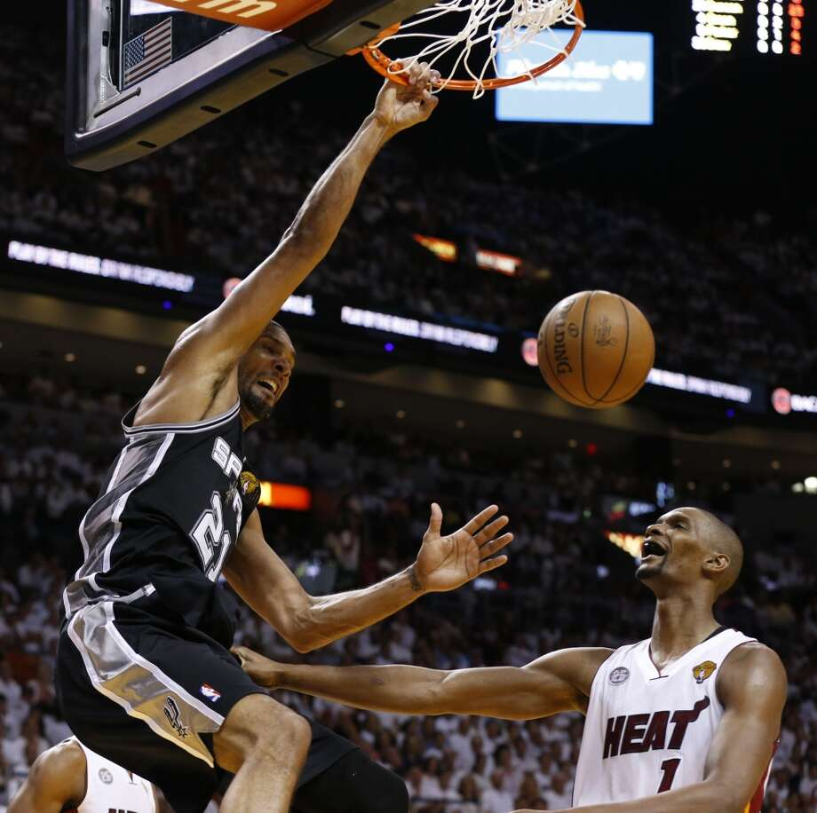 San Antonio Spurs' Tim Duncan dunks over Miami Heat's Chris Bosh during first half action in Game 6 of the 2013 NBA Finals Tuesday, June 18, 2013 at American Airlines Arena in Miami. (Edward A. Ornelas/San Antonio Express-News)