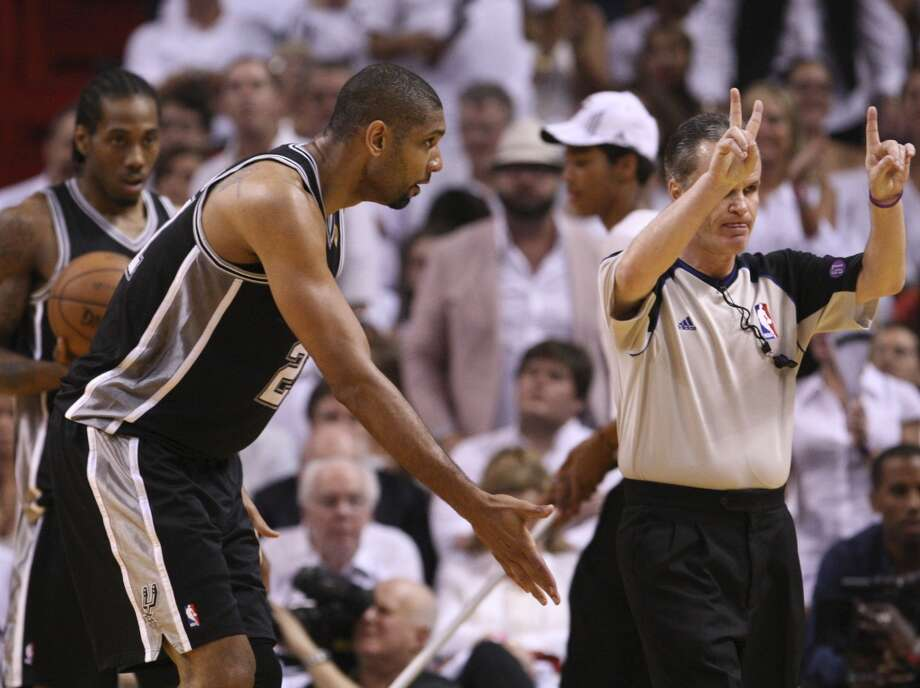 San Antonio Spurs' Tim Duncan talks with referee Mike Callahan during first half action in Game 6 of the 2013 NBA Finals Tuesday, June 18, 2013 at American Airlines Arena in Miami. (Edward A. Ornelas/San Antonio Express-News)