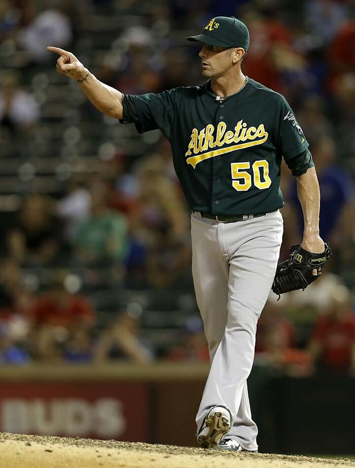 Grant Balfour didn't get a save, but pitched a 1-2-3 ninth inning to nail down the A's win. Photo: Tony Gutierrez, Associated Press