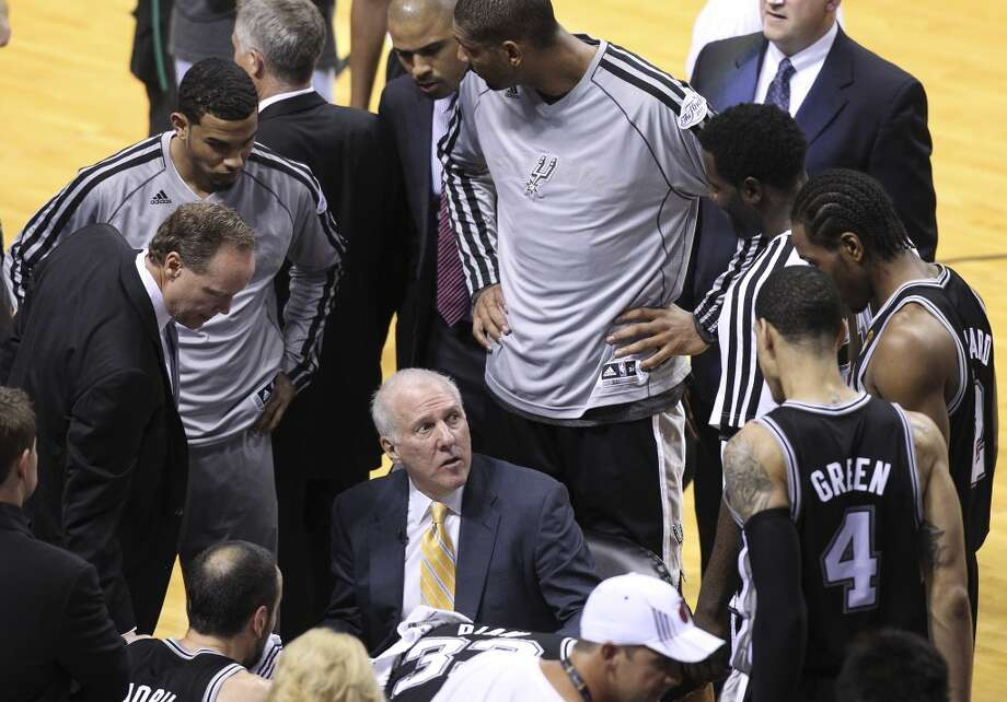 San Antonio Spurs head coach Gregg Popovich talks to the team during a time out during the first half of Game 6 of the NBA Finals at American Airlines Arena on Tuesday, June 18, 2013 in Miami. (Kin Man Hui/San Antonio Express-News)