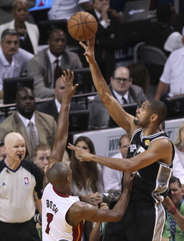 San Antonio Spurs' Tim Duncan shoots over Miami Heat's Chris Bosh during the first half of Game 6 of the NBA Finals at American Airlines Arena on Tuesday, June 18, 2013 in Miami. (Kin Man Hui/San Antonio Express-News)