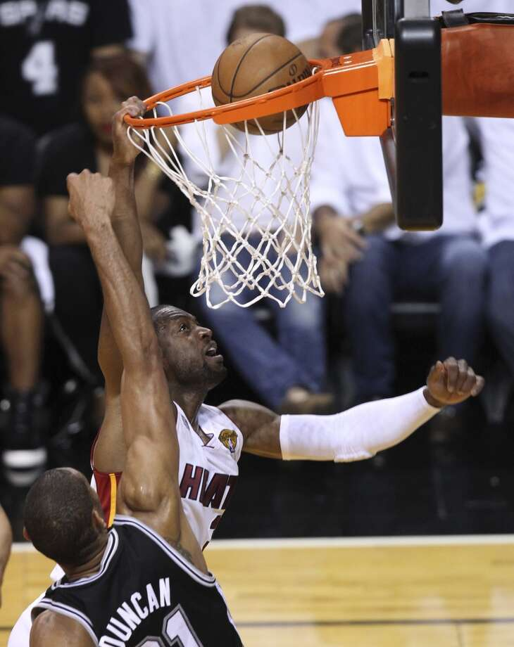 Miami Heat's Dwyane Wade shoots over San Antonio Spurs' Tim Duncan during the first half of Game 6 of the NBA Finals at American Airlines Arena on Tuesday, June 18, 2013 in Miami. (Kin Man Hui/San Antonio Express-News)