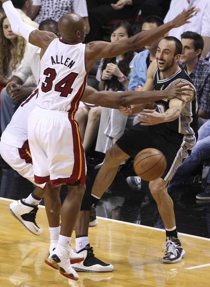 San Antonio Spurs' Manu Ginobili passes to a team mate while under pressure from Miami Heat's Ray Allen during the first half of Game 6 of the NBA Finals at American Airlines Arena on Tuesday, June 18, 2013 in Miami. (Kin Man Hui/San Antonio Express-News)