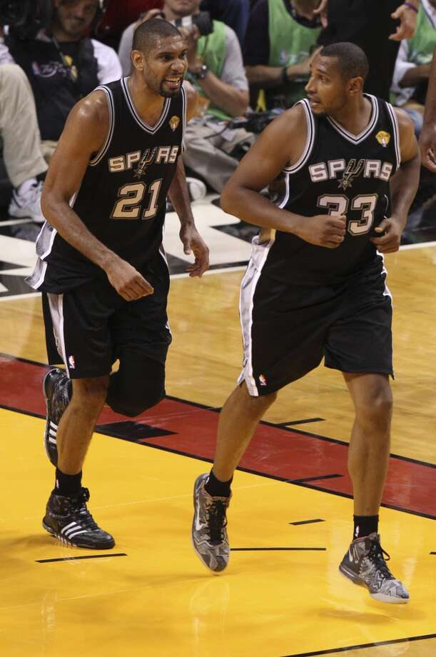 San Antonio Spurs' Tim Duncan and Boris Diaw run back up court during the first half of Game 6 of the NBA Finals at American Airlines Arena on Tuesday, June 18, 2013 in Miami. (Kin Man Hui/San Antonio Express-News)