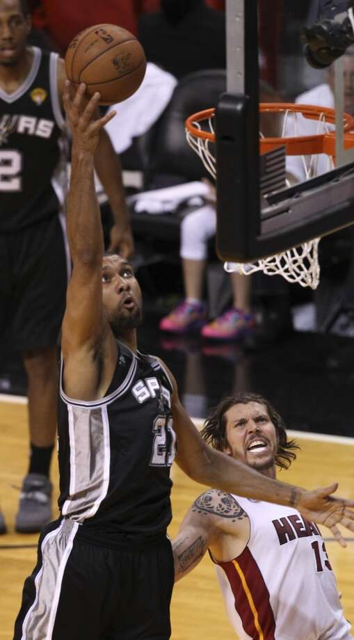San Antonio Spurs' Tim Duncan shoots over Miami Heat's Mike Miller during the second half of Game 6 of the NBA Finals at American Airlines Arena on Tuesday, June 18, 2013 in Miami. (Kin Man Hui/San Antonio Express-News)
