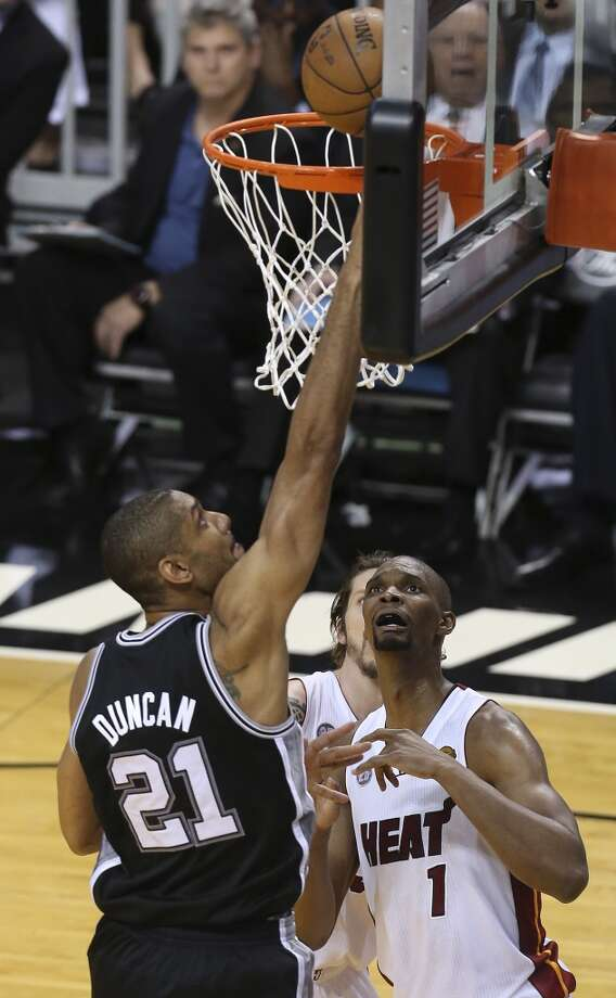 San Antonio Spurs' Tim Duncan shoots over Miami Heat's Chris Bosh during the first half of Game 6 of the NBA Finals at American Airlines Arena on Tuesday, June 18, 2013 in Miami. (Jerry Lara/San Antonio Express-News)