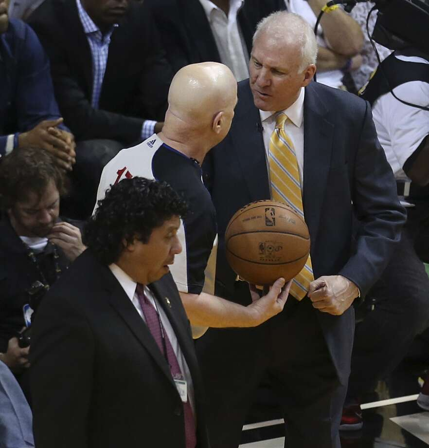 San Antonio Spurs head coach Gregg Popovich talks to referee Joey Crawford during the first half of Game 6 of the NBA Finals at American Airlines Arena on Tuesday, June 18, 2013 in Miami. (Jerry Lara/San Antonio Express-News)