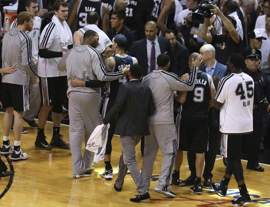 The Spurs go to the sideline for a time out during the first half of Game 6 of the NBA Finals at American Airlines Arena on Tuesday, June 18, 2013 in Miami. (Jerry Lara/San Antonio Express-News)