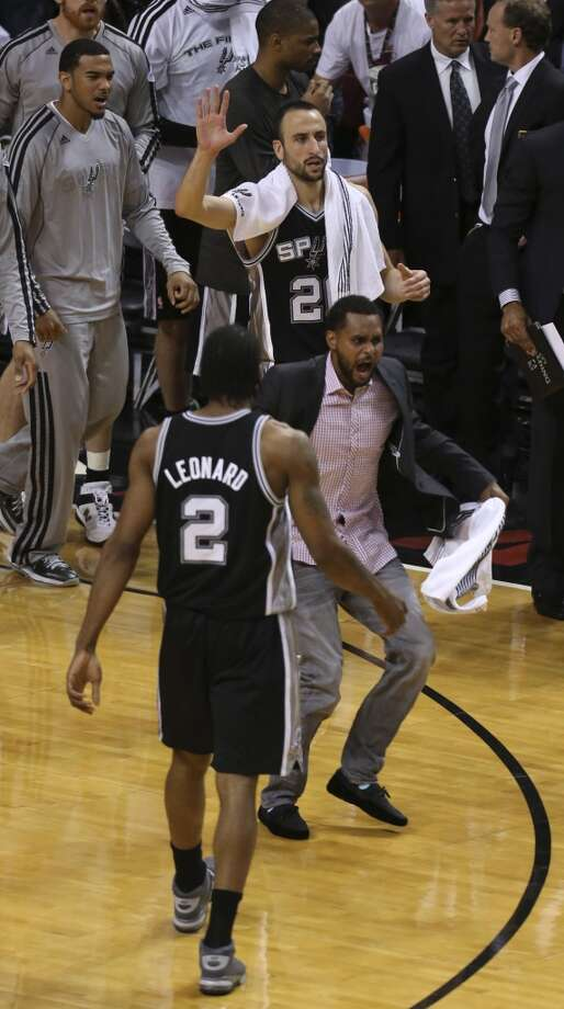 The Spurs reatc as the Heat call a time out during the first half of Game 6 of the NBA Finals at American Airlines Arena on Tuesday, June 18, 2013 in Miami. (Jerry Lara/San Antonio Express-News)
