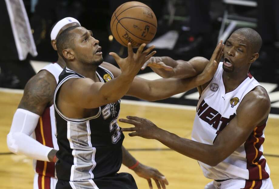 San Antonio Spurs' Boris Diaw shoots over Miami Heat's LeBron James and Chris Bosh during the first half of Game 6 of the NBA Finals at American Airlines Arena on Tuesday, June 18, 2013 in Miami. (Jerry Lara/San Antonio Express-News)