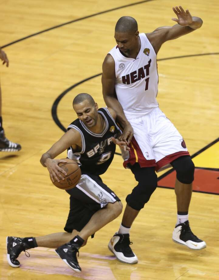 San Antonio Spurs' Tony Parker collides with Miami Heat's Chris Bosh during the first half of Game 6 of the NBA Finals at American Airlines Arena on Tuesday, June 18, 2013 in Miami. (Jerry Lara/San Antonio Express-News)