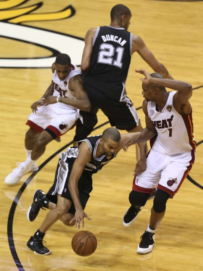 San Antonio Spurs' Tony Parker drives around Miami Heat's Chris Bosh during the first half of Game 6 of the NBA Finals at American Airlines Arena on Tuesday, June 18, 2013 in Miami. (Jerry Lara/San Antonio Express-News)