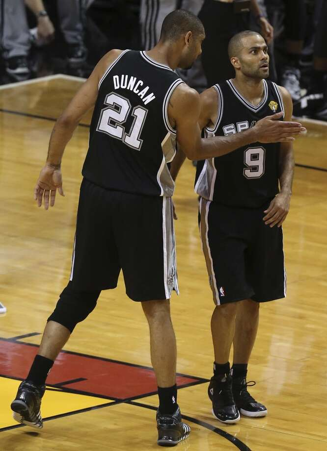 San Antonio Spurs' Tim Duncan reacts with Tony Parker during the second half of Game 6 of the NBA Finals at American Airlines Arena on Tuesday, June 18, 2013 in Miami. (Jerry Lara/San Antonio Express-News)