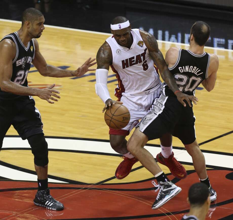 Miami Heat's LeBron James tries to get between the San Antonio Spurs' Tim Duncan and Manu Ginobili during the second half of Game 6 of the NBA Finals at American Airlines Arena on Tuesday, June 18, 2013 in Miami. (Jerry Lara/San Antonio Express-News)